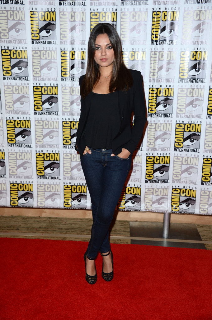 Mila Kunis opted for a sleek, casual outfit, wearing dark denim with black separates on top.