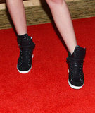 In true Kristen Stewart form, the starlet traded in her heels for a supercool pair of black Barbara Bui sneakers.