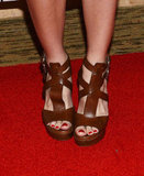 We love Ashley's edgy yet totally classic Michael Kors sandals.