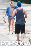 Miley Cyrus walked towards Liam Hemsworth with her skateboard in LA.