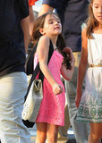 Suri Cruise pushed her hair off her shoulders.