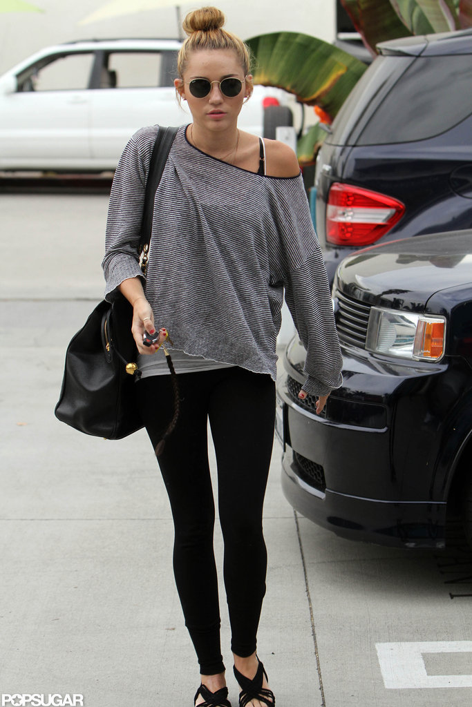 Miley Cyrus locked her car as she walked into Pilates in LA.