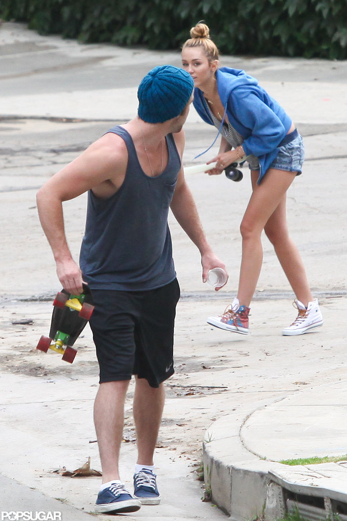 Miley Cyrus wore a blue hooded sweatshirt while Liam Hemsworth was in a tank top to skateboard around LA.