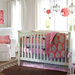 You can almost hear the twang of the sitar in the new Indian-style Lena nursery (fitted sheet, $19, crib skirt, $59, and bumper, $99). The rich colors and beautifully patterned pieces help add some drama to the room.