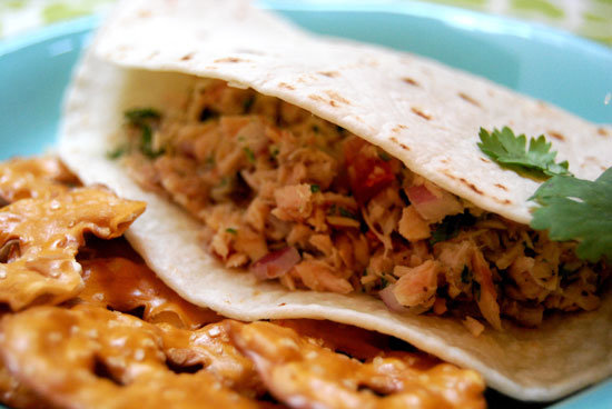 Protein-packed and easy to make, this good-for-you tuna salad recipe makes for a great weekday lunch or dinner. Mayo gets swapped out with heart-healthy olive oil, and the pita of choice is whole wheat. In the end, one tuna salad pita pocket amounts to 391 calories and 30 grams of protein.