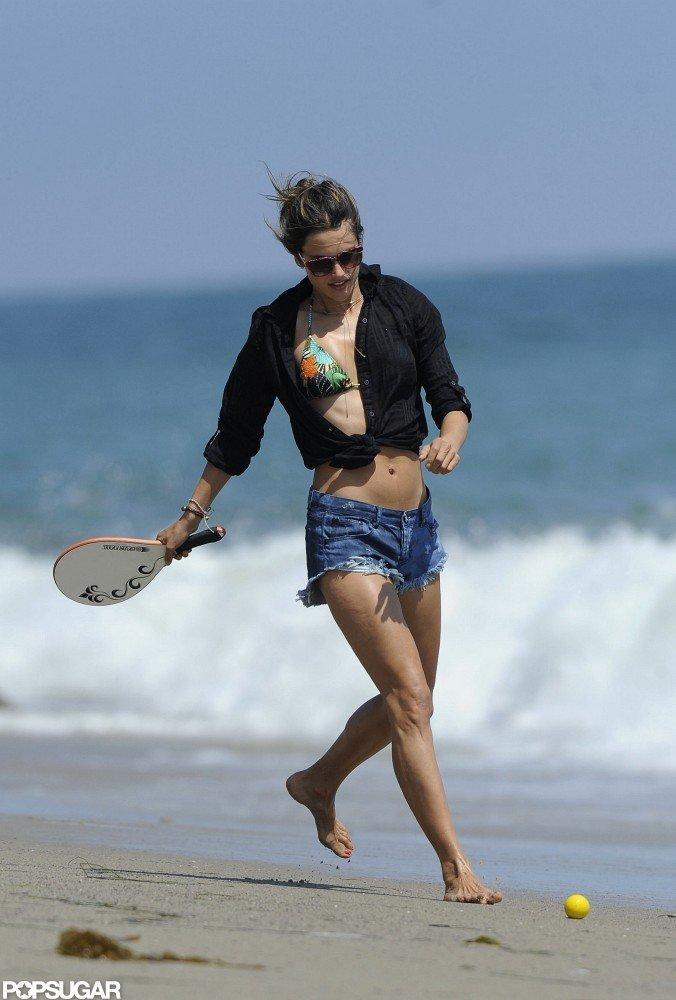 Alessanda Ambrosio ran on the beach.