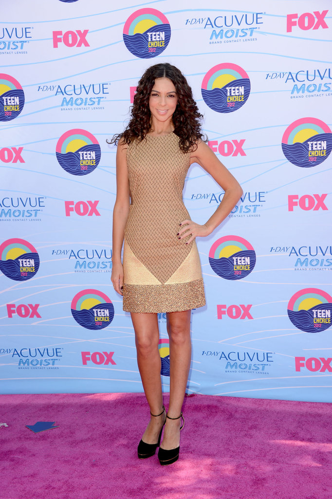 Terri Seymour opted for a camel hued dress and black ankle strap pumps.