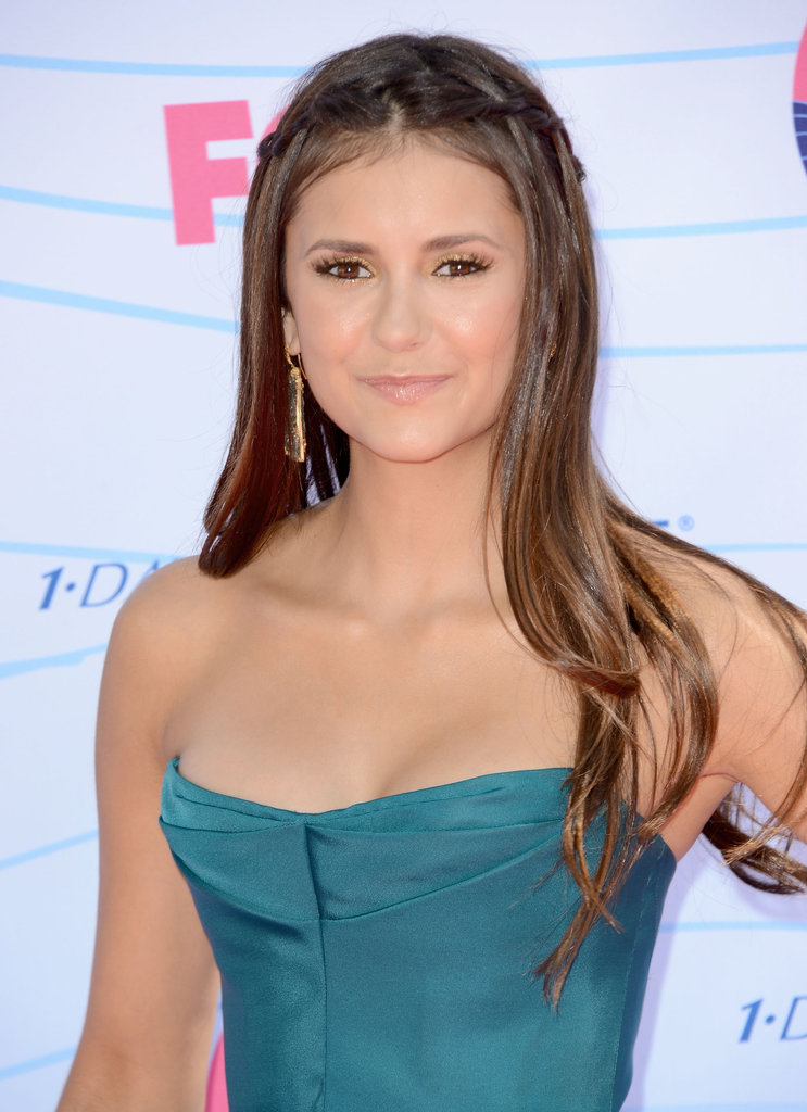A close-up of Nina Dobrev's look.