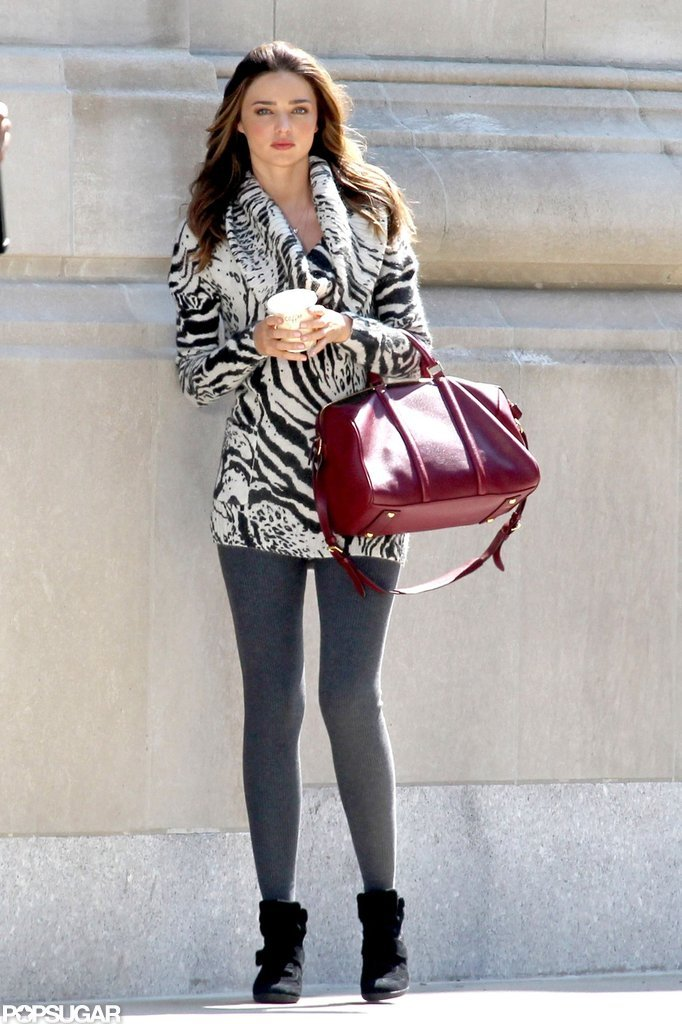 Miranda Kerr wore a printed sweater and leggings while shooting a Victoria's Secret campaign in NYC.