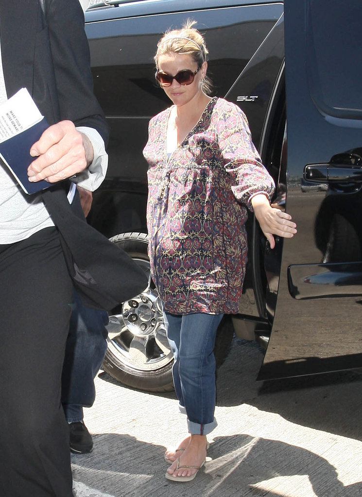 Reese Witherspoon wore sandals and cuffed jeans as she arrived at the airport in LA.
