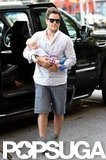Mike Comrie carried Luca Comrie as he and Hilary Duff arrived in NYC.