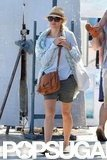 Naomi Watts sported a cute brown shoulder bag.