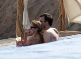 Lauren Conrad showed PDA poolside with William Tell while on a Cabo getaway in July 2012.