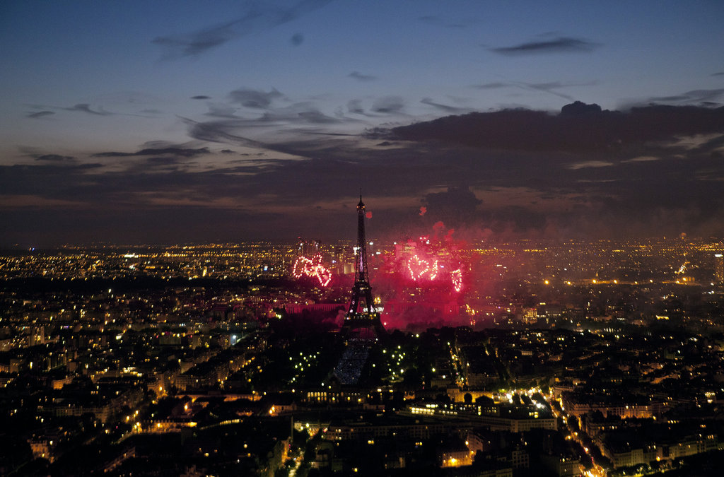 Heart fireworks exploded beside the Eiffel Tower as part of the Bastille Day celebrations.