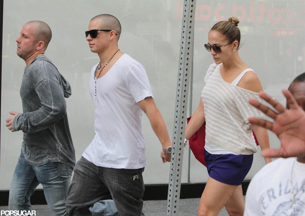 Jennifer Lopez and Casper Smart held hands.