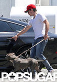 Josh Hutcherson returned to his car with his dog, Driver.