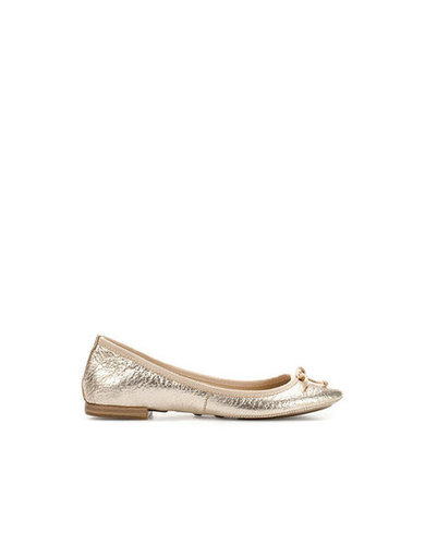 A metallic ballet flat is just as polished as your work pumps, but it's a whole lot comfier.  Zara Patent Ballerina ($80)