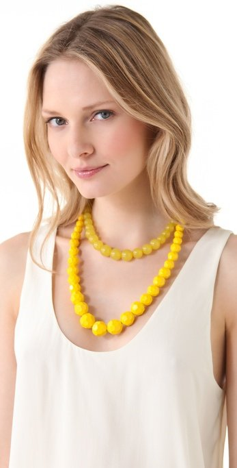 This necklace would lend megawatt color to your workwear.  Adia Kibur Layered Beads Necklace ($45)