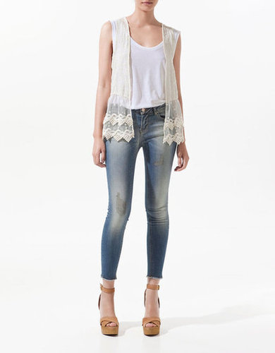 When it's too hot for a jacket, a pretty lace waistcoat like this will polish up your white tees and tanks without adding bulk.  Zara Embroidered Waistcoat With Lace Trim ($50)