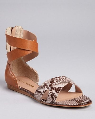 These sandals were made for walking with a secure zippered back and comfy soles.  Pour La Victoire Fabia Flat Sandals ($126, originally $210)