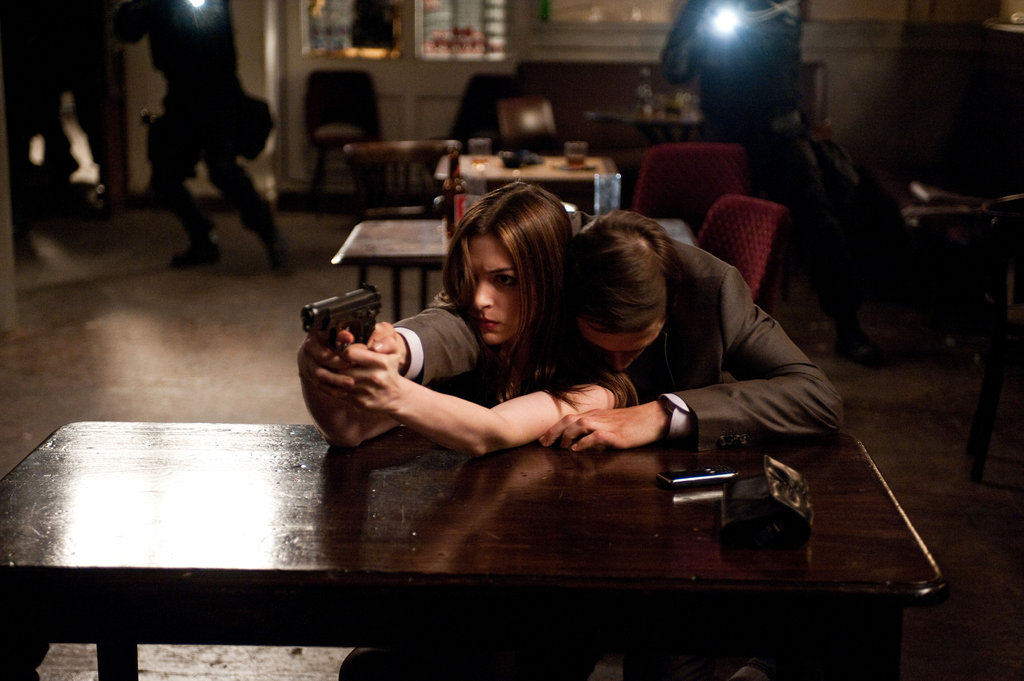 Anne Hathaway and Burn Gorman in The Dark Knight Rises. Photo courtesy of Warner Bros.