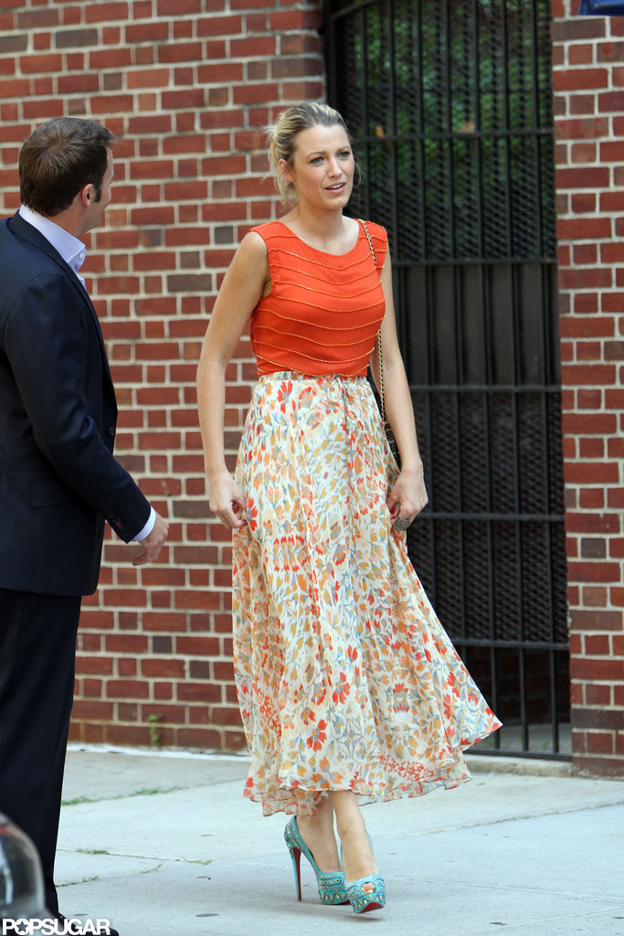 Blake Lively wore an orange top with a matching skirt in NYC.