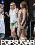 Dakota Fanning and Elizabeth Olsen shared a laugh on set.