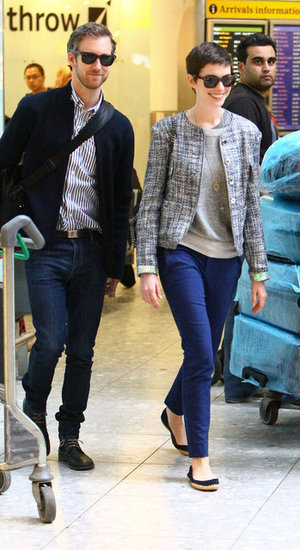 Anne Hathaway and Adam Shulman arrived in London.