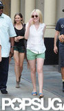 Dakota Fanning kept cool in a sleeveless button-down and green shorts.