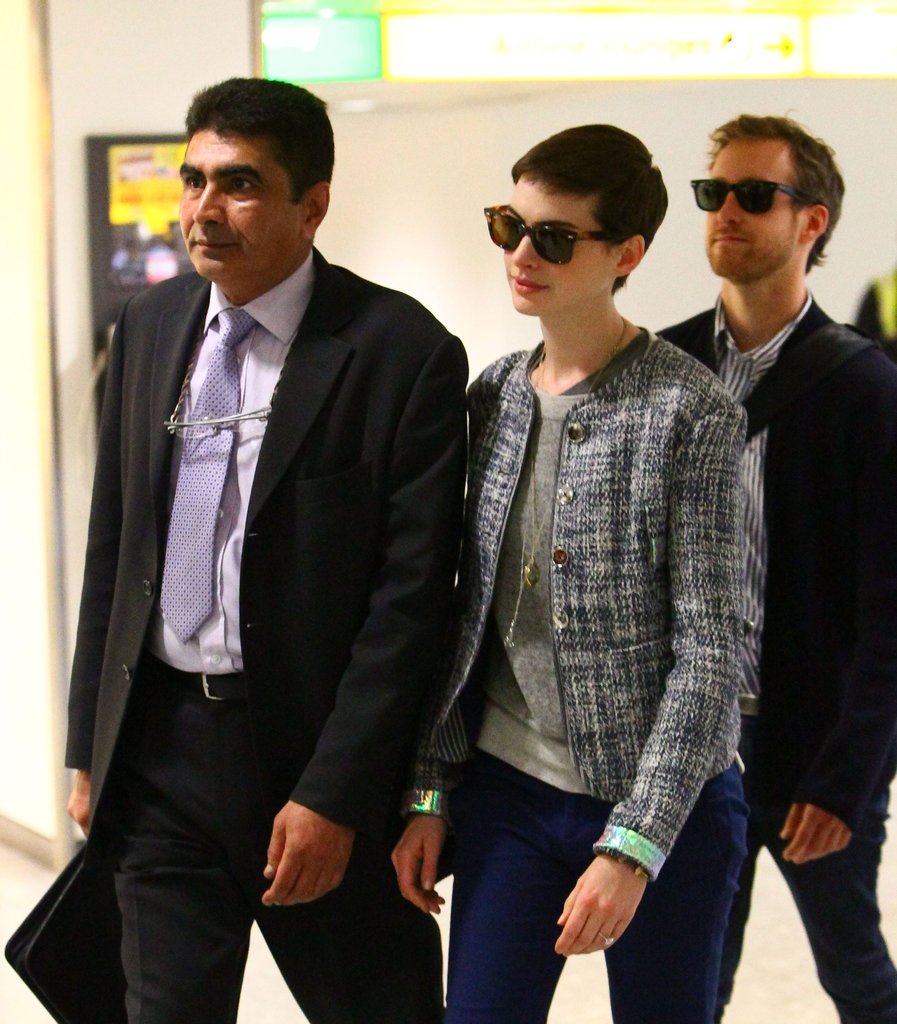 Anne Hathaway and Adam Shulman arrived at Heathrow.