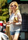Kirsten Dunst carried a small clutch with her as she ran errands.