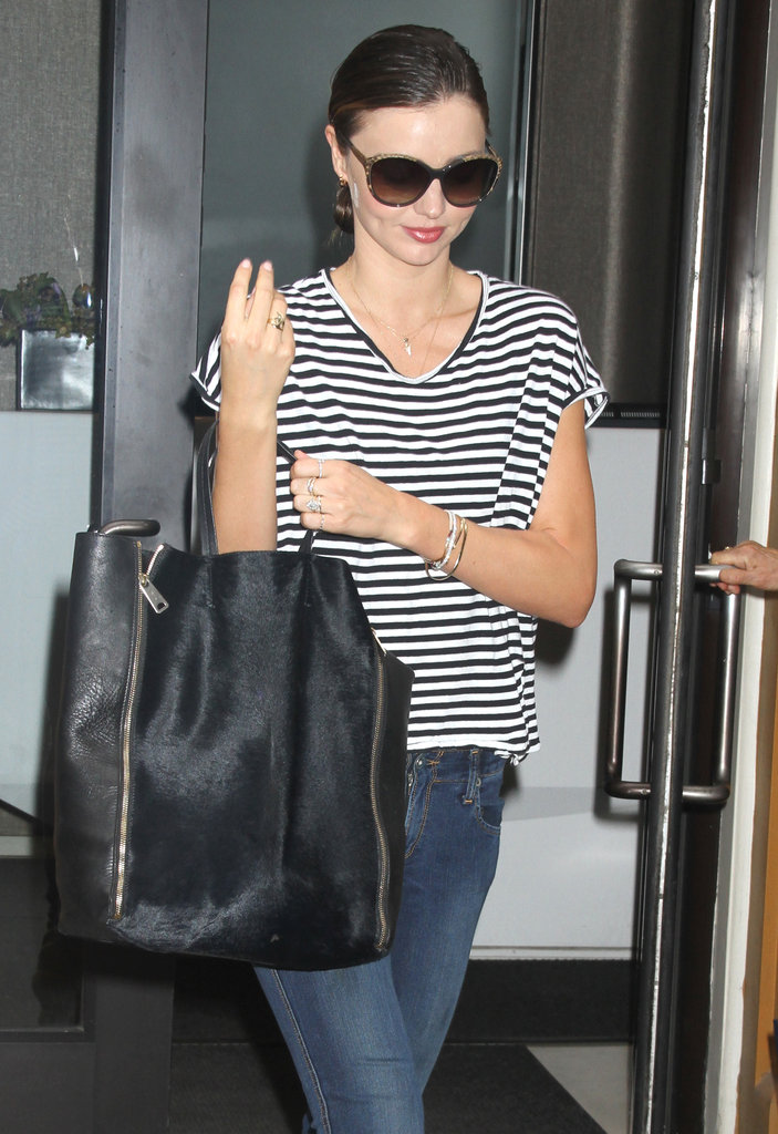 Miranda Kerr carried a large tote.