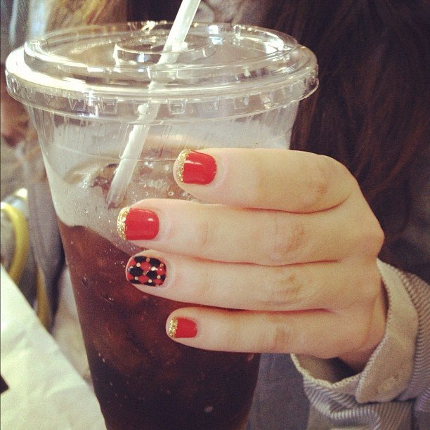 Zooey Deschanel showed off her killer nail art. Source: Instagram user hellogiggles