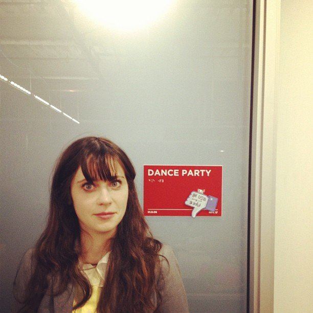 Zooey Deschanel struck a pose in front of the Dance Party door. Source: Instagram user hellogiggles