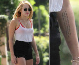 "Miley Cyrus added an inscription to the inside of her left forearm that reads: ""So that his place shall never be with those cold and timid souls who knew neither victory nor defeat."" The quote is from a speech given by President Theodore Roosevelt in 1910."