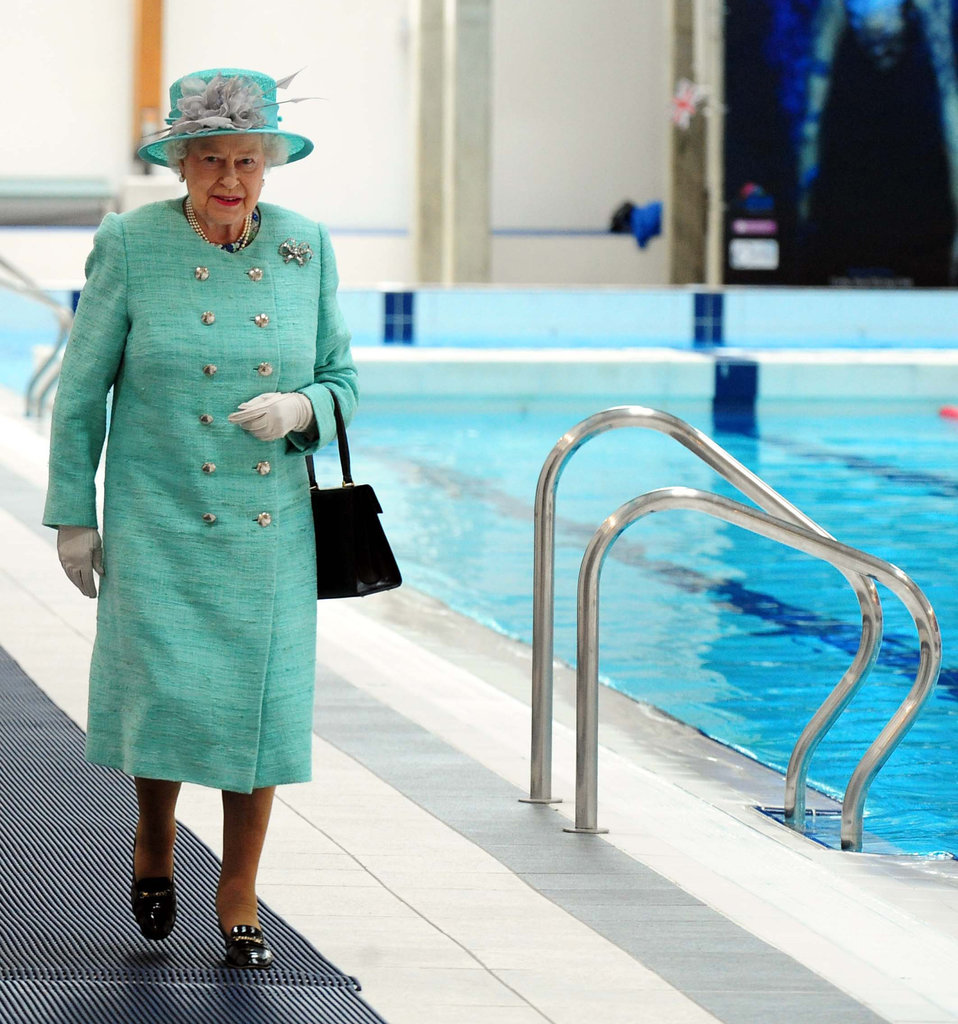 Queen Elizabeth II inspected the Olympic swimming pool.