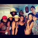 Rihanna posed with Magic Johnson while on a vacation with friends. Source: Instagram user badgalriri
