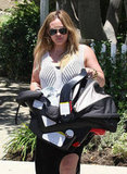 Hilary Duff carried Luca into a birthday party in LA.