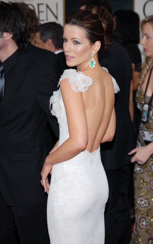 Showing skin in a backless gown, Kate Beckinsale attended the Golden Globes in January 2006.
