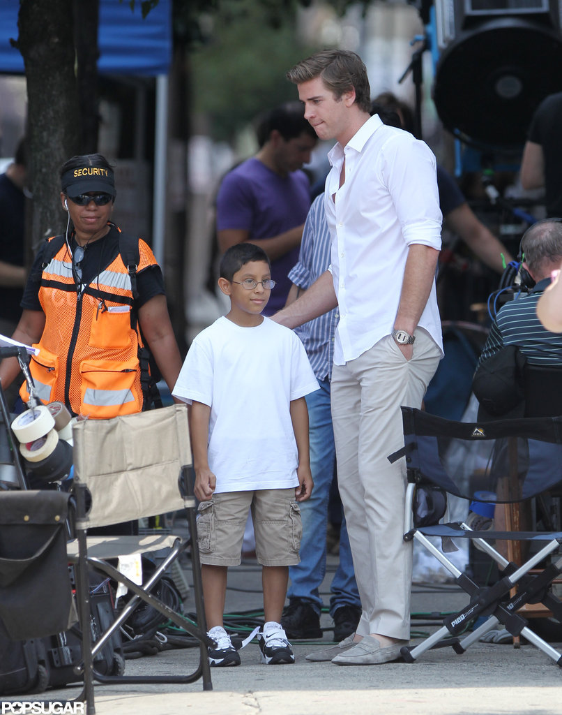 Liam Hemsworth talked to cast and crew members on the set of Paranoia in Philadelphia, PA.
