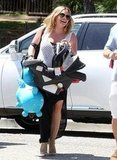 Hilary Duff laughed as she carried Luca in LA.