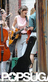 Keira Knightley was all smiles with her guitar while shooting a scene for Can a Song Save Your Life? in NYC.