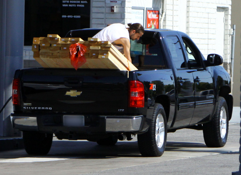 Shia LaBeouf secured the lumber in the back of his truck.