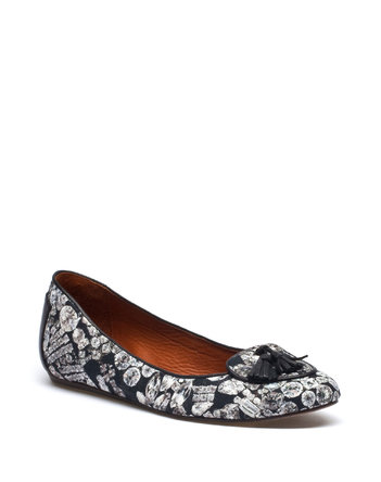 Wear your diamonds on your feet with these graphic floral flats. Lanvin Flat Loafer in Printed Canvas ($335)