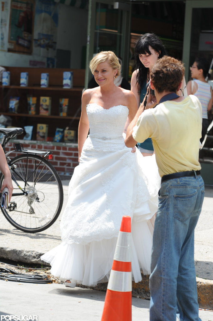 Amy Poehler in a wedding dress as she shot They Came Together.