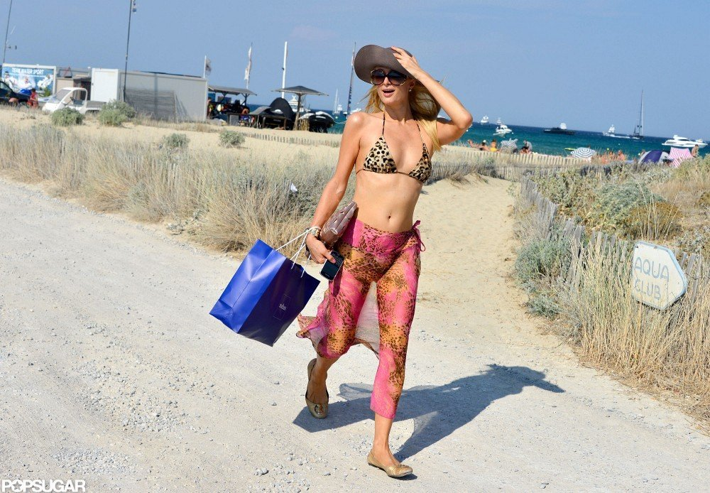 Paris Hilton had to hold on to her hat to keep it from flying away.