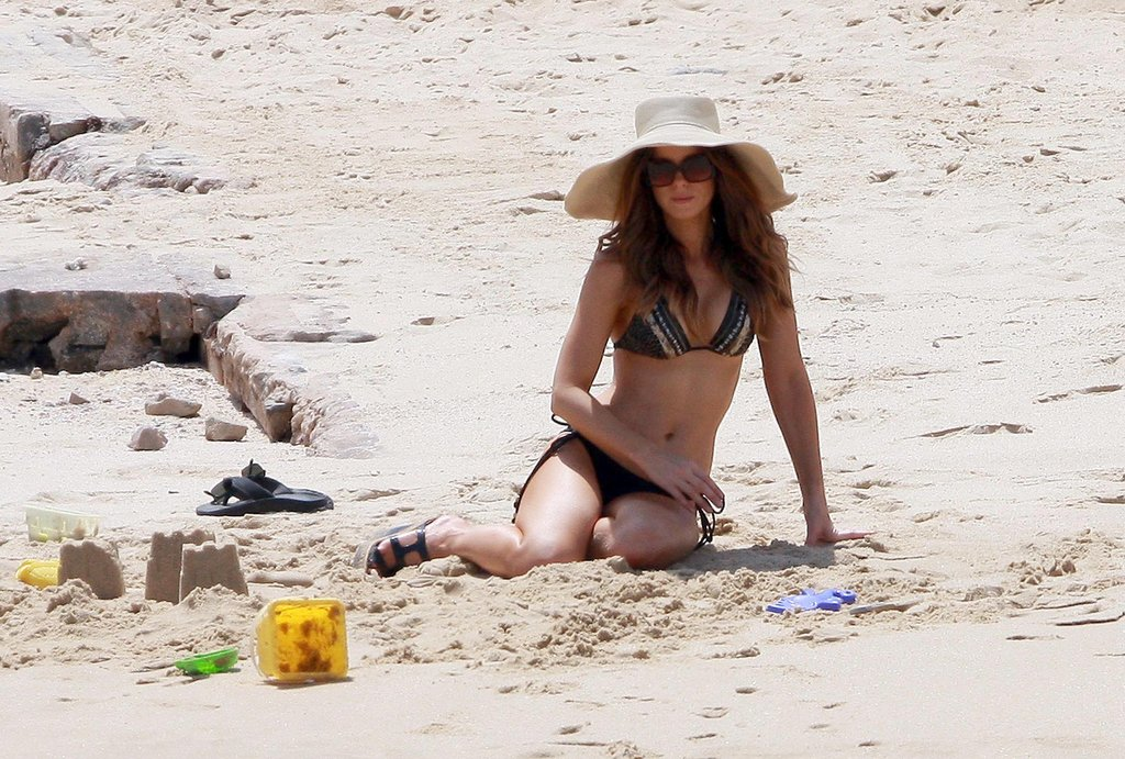 Kate Beckinsale lounged in the sand during a September 2010 trip to Mexico.