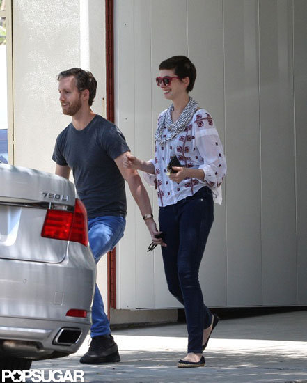 Anne Hathaway and Adam Shulman had a laugh together as they headed to their car.
