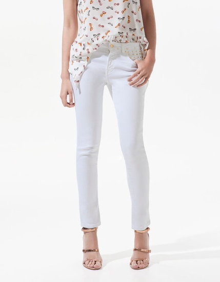 Offset a white skinny jean with edgier metal accents. (Hello, studs!) Zara Studded Slim Fit Pop Jeans ($40, originally $90)