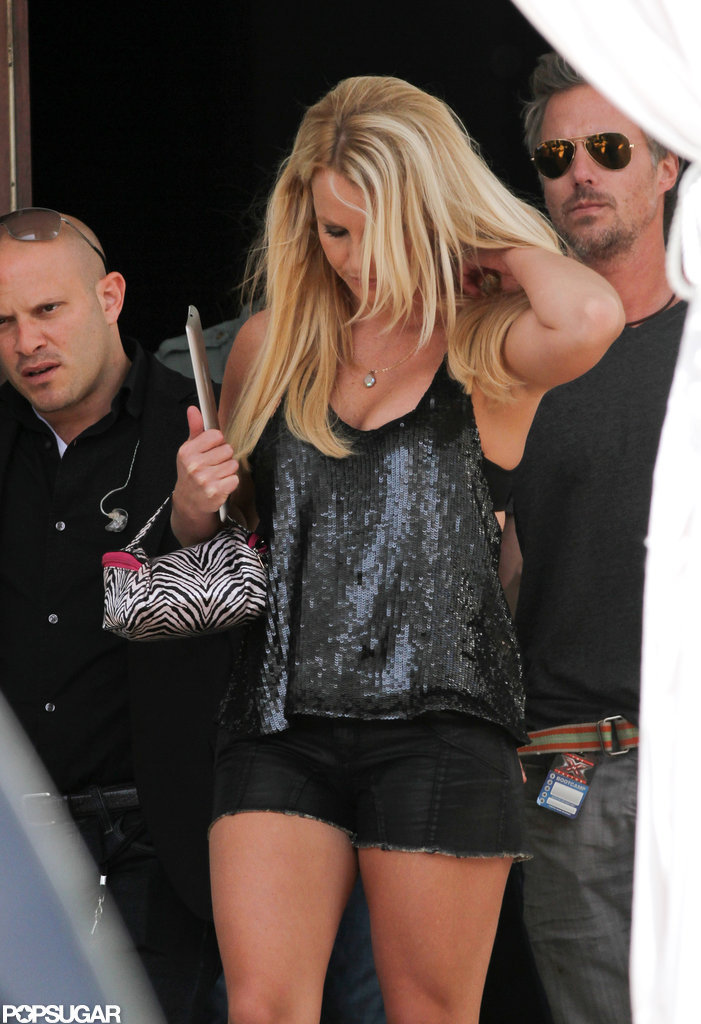 Britney Spears fixed her hair.